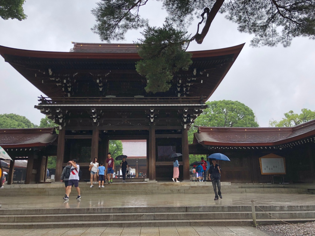 a shrine in the rain with steps leading up