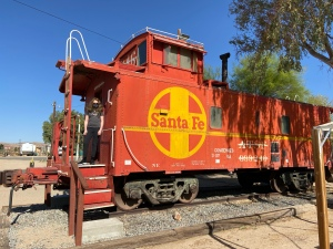 picture of orange train car with yellow Santa Fe symbol in yellow